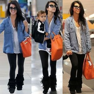 Minnetonka trendy black fringe boots, 6.5